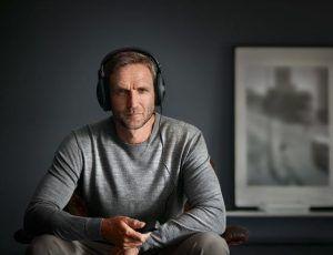 Man sitting with headphones on.